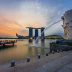 Rear view of the Merlion statue at Merlion Park Singapore with Marina Bay Sands in the distance